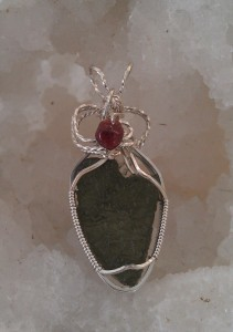 Moldavite with Garnet