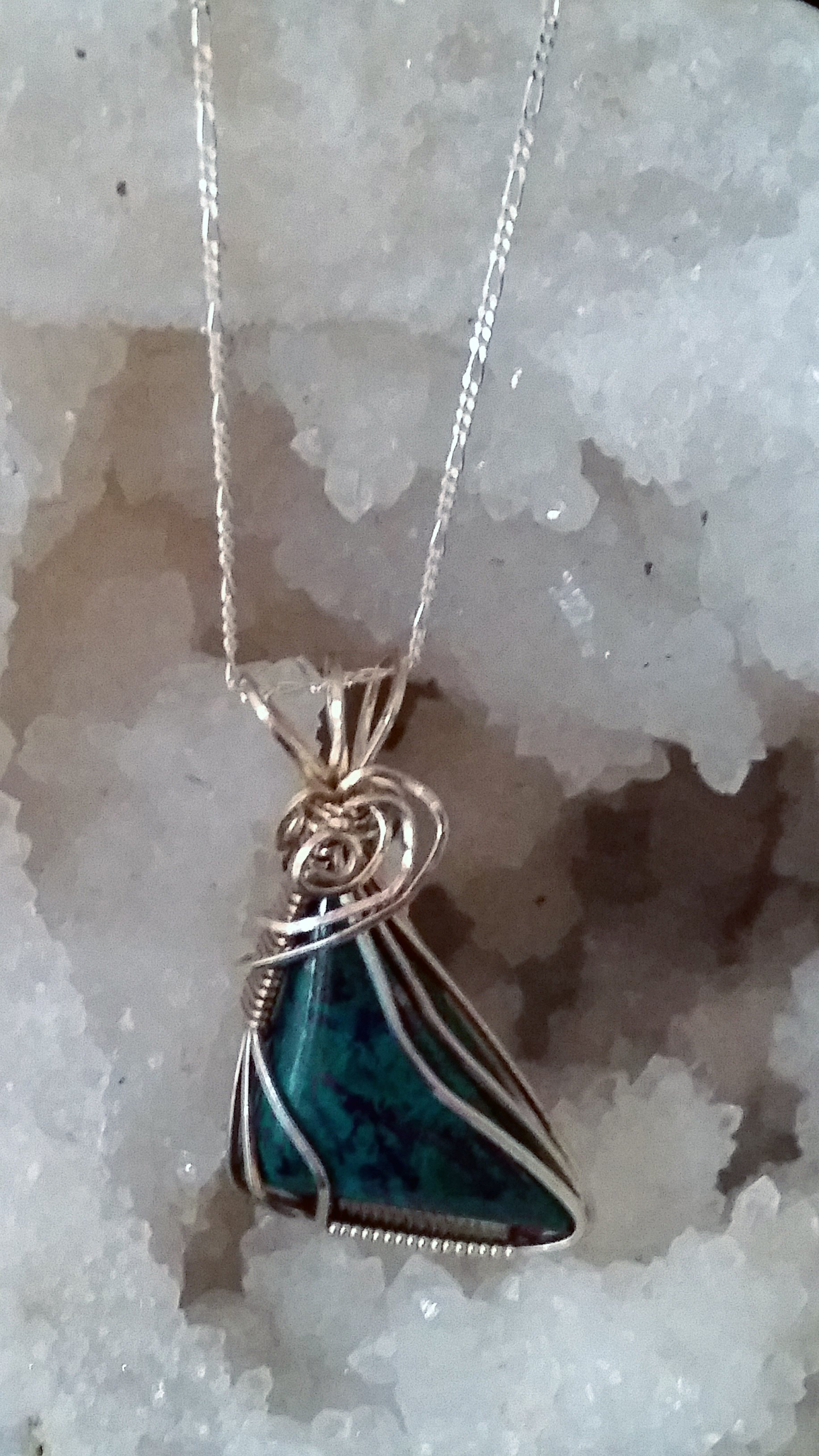 The beautiful combination of Malachite-Chrysocolla brings serenity, tranquility, and calming energies, making it a beautiful crystal to wear as a pendant. It brings the energy of new beginnings, helping to facilitate smooth transitions in times of change. Working with Malachite-Chrysocolla is one of the most healing ways to release emotional blockages. It is also invaluable in creative expression.