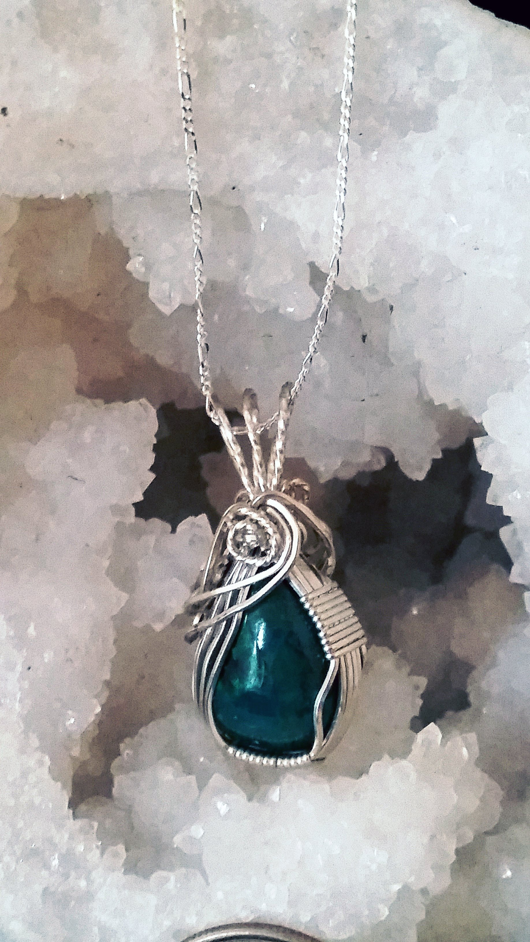 This beautiful Malachite-Chrysocolla pendant brings serenity, tranquility, and calming energies, making it a beautiful crystal to wear as a pendant. It brings the energy of new beginnings, helping to facilitate smooth transitions in times of change.