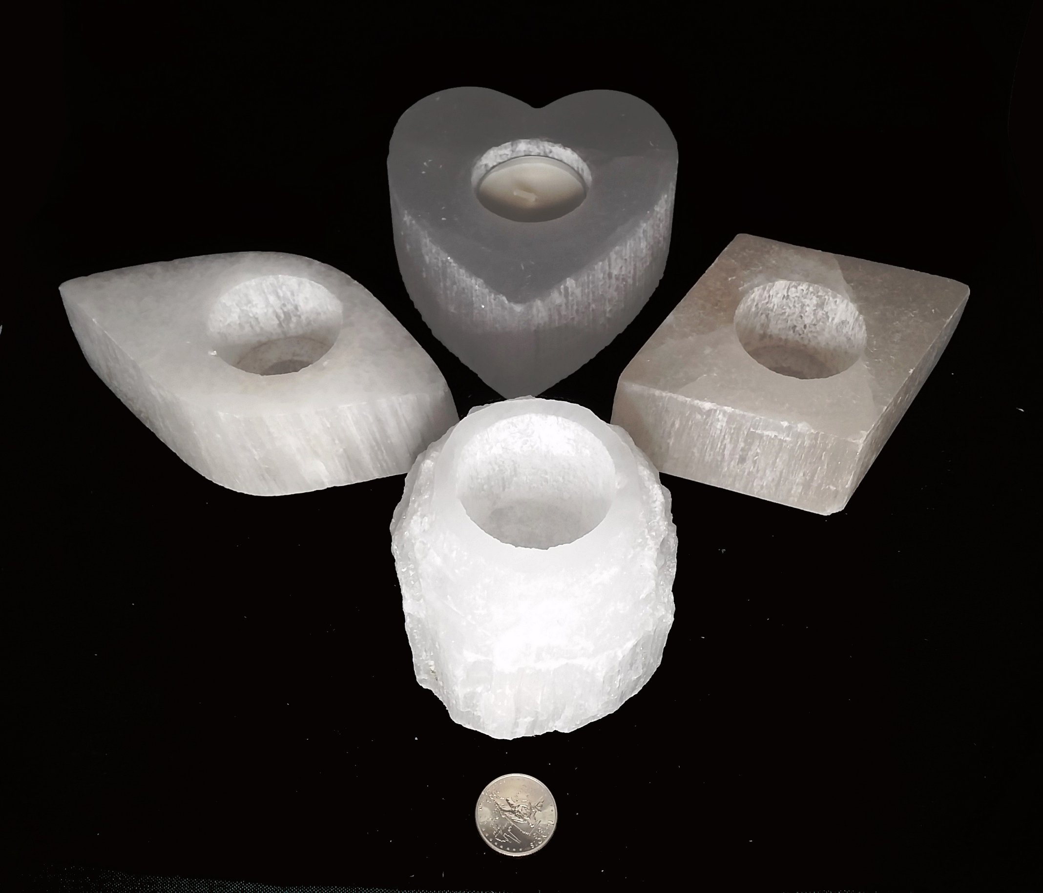 An amazing stone of cleansing and clearing, Selenite naturally dispels negative energy, removes energy blocks, and charges and amplifies other stones. Never needing clearing of its own, it is a must-have in your home.   These glowing and gorgeous Selenite candleholders will supercharge and cleanse you and your home with color, light, and high vibrations.  a rainbow light-changing box!