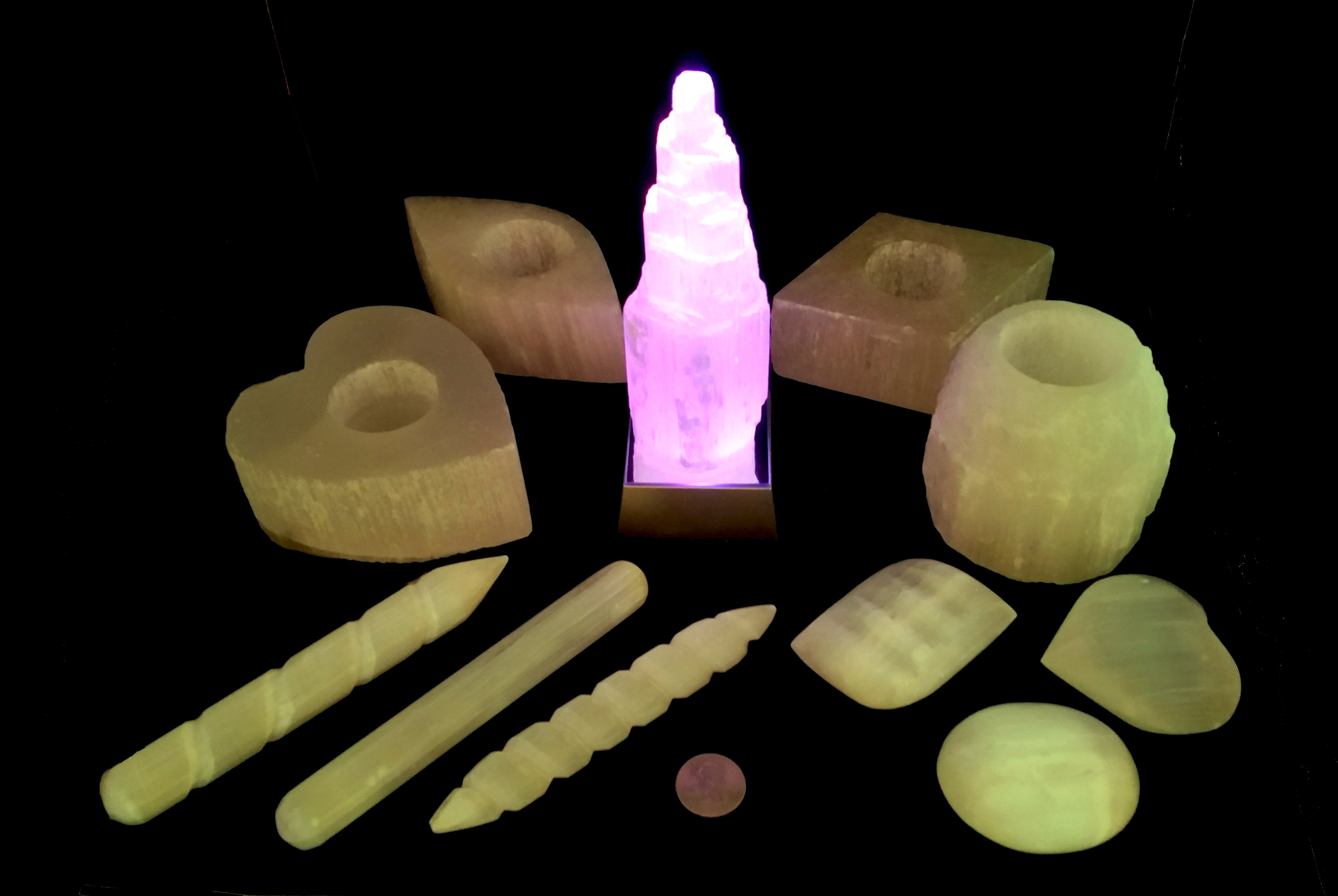 Your special, exclusive Heart & Soul Colors Selenite Cleaning & Clearing Collection includes three wands, three healings stones, four candle holders, one tower (raw or spiral - you pick!), and a rainbow light-changing box!  Known as 'Liquid Light,' this special stone radiates and attracts all the good vibes we all need!